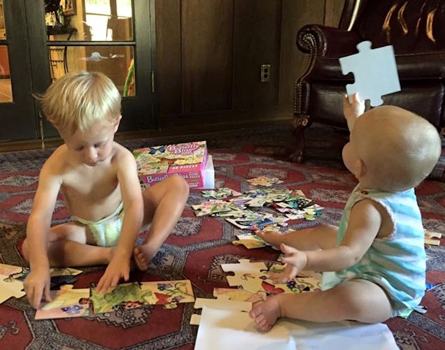 Betsy smith two kids with puzzle